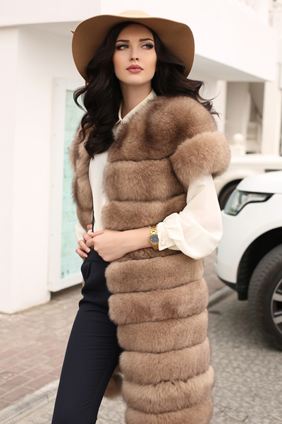 woman in fur coat with hat